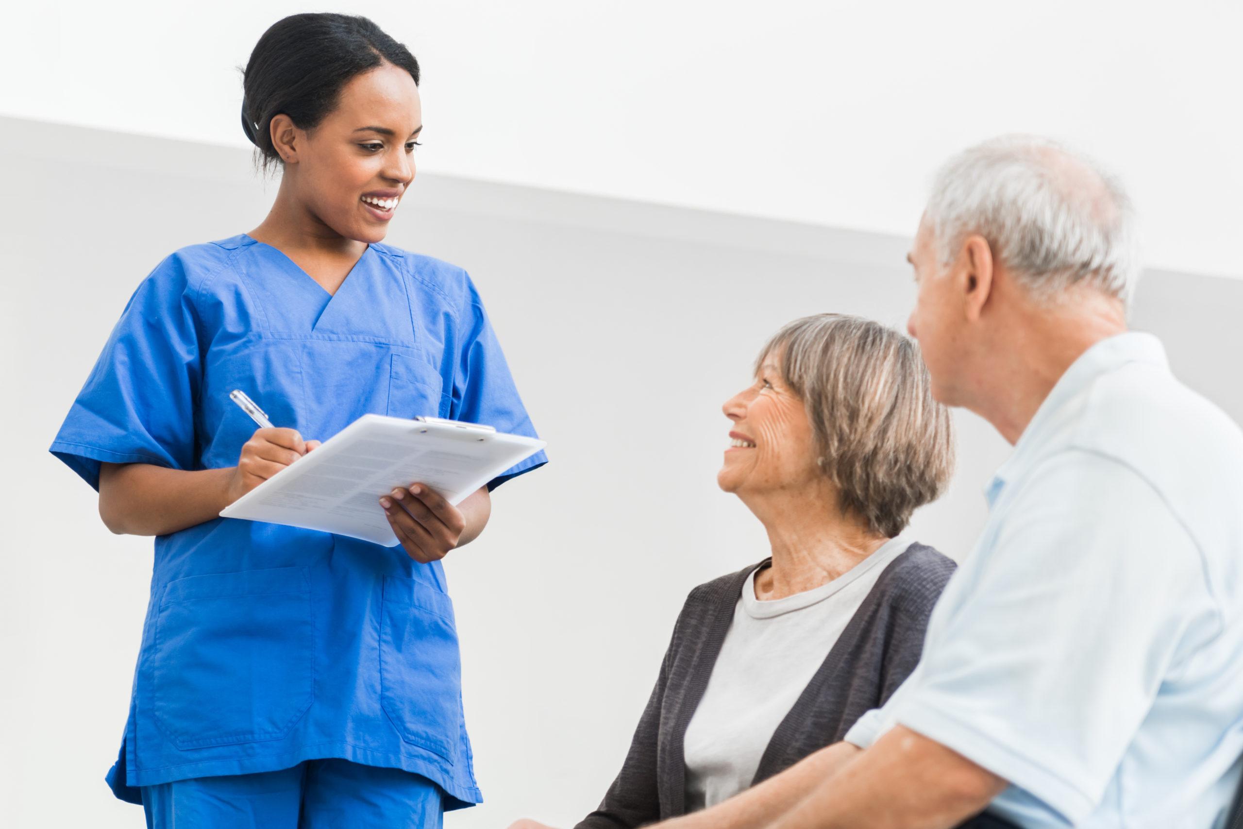 Nurse Welcomes Senior Couple in Hospital.